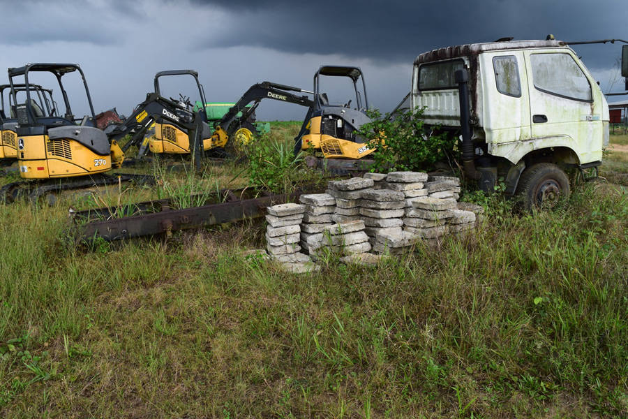 Equipment abandoned by company on disputed site of banana plantation