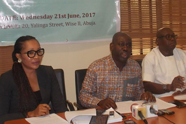 From right to left: Doifie Buokoribo (Board member), Isaac 'Asume' Osuoka (Executive Director), Vivian Bellonwu-Okafor (Head of Advocacy) addressing the media at Social Action's National Advocacy Centre, Abuja