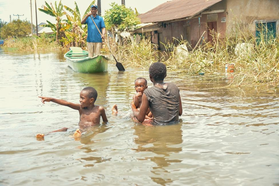 Children bathing in flood waters