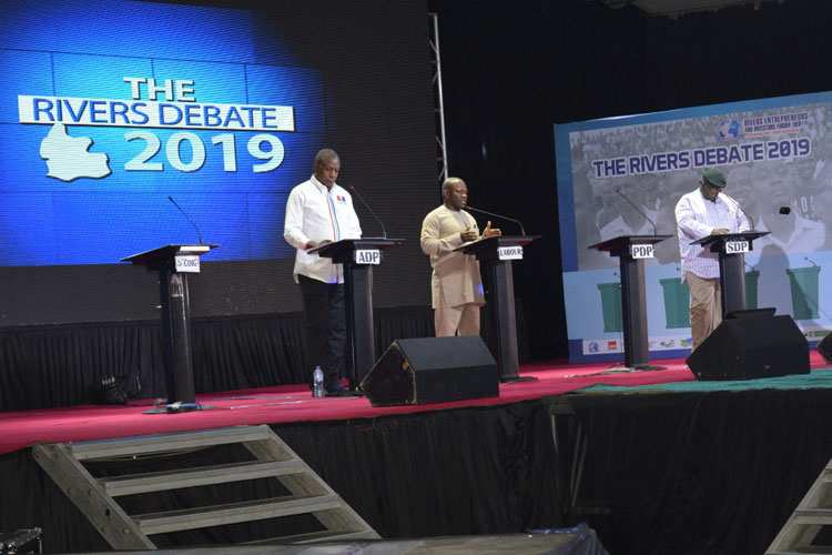 Figure-From-left-to-right,-Mr-Victor-Fingesi-(ADP),-Chief-Isaac-Wonwu-(Labour-Party)-and-Chief-Precious-Elekima-(SDP)-on-the-podium-for-the-River-Debate-2019