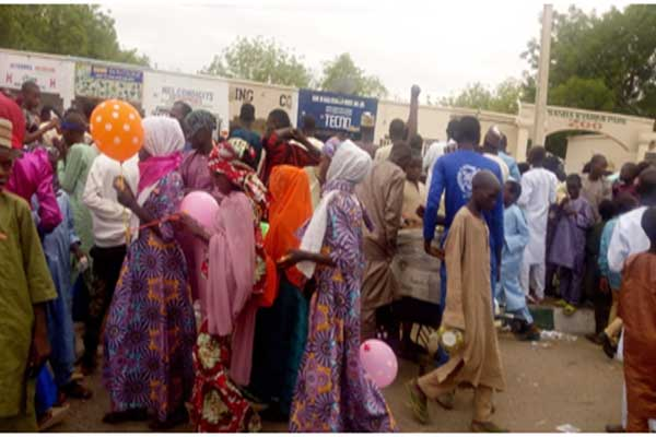 Children-and-youths,-out-to-celebrate-the-Eid-el-Fitr,-hover-around-the-gate-of-the-Maiduguri-City-Zoo