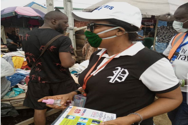 CSO-COVID-19-Situation-Room-distributing-flyers-and-hand-sanitisers-to-members-of-the-public-in-Bayelsa-State